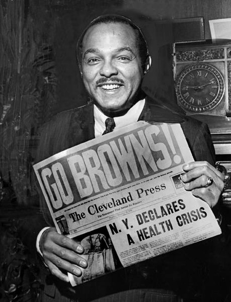 Mayor Carl B. Stokes holds a copy of the Cleveland Press