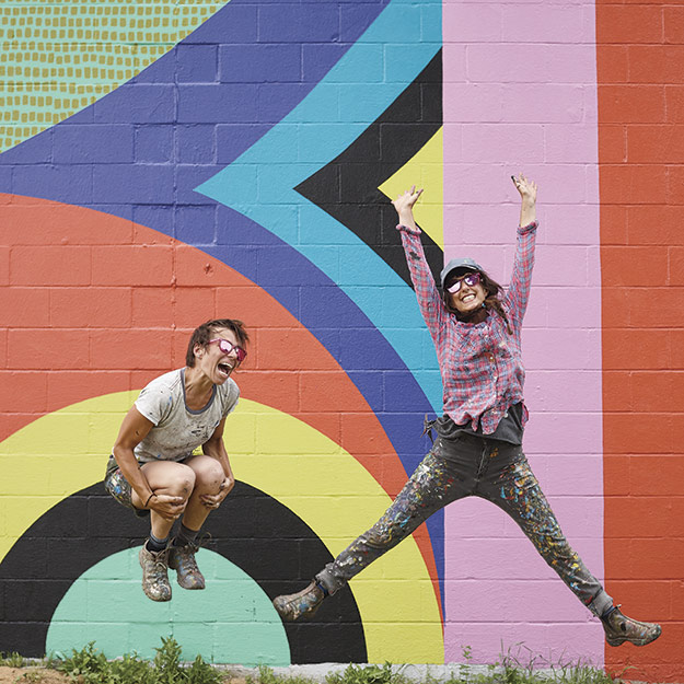 """Katey Truhn and Jessie Unterhalter with their mural """"Land Ahoy"""""""