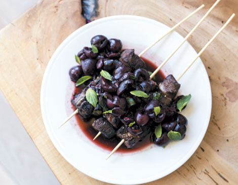 Grilled steak kebabs with macerated Ohio cherries and basil