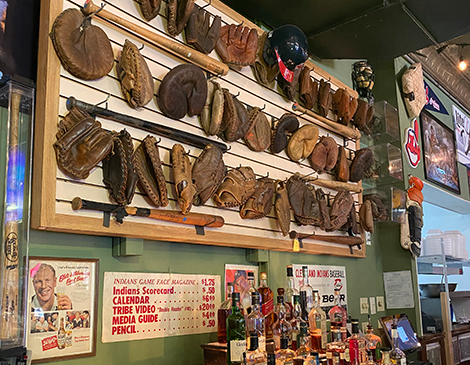 O'Toole's Tavern and Gallery's wall of baseball mitts shows how gloves have changed over time.