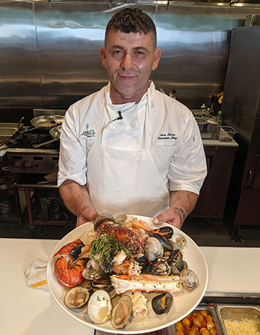 Luca Sema shows off the Mare seafood platter.