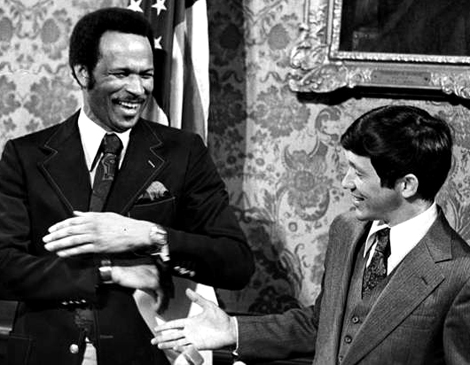 article_George_Forbes_and_Dennis_Kucinich_share_a_lighthearted_moment_at_City_Hall