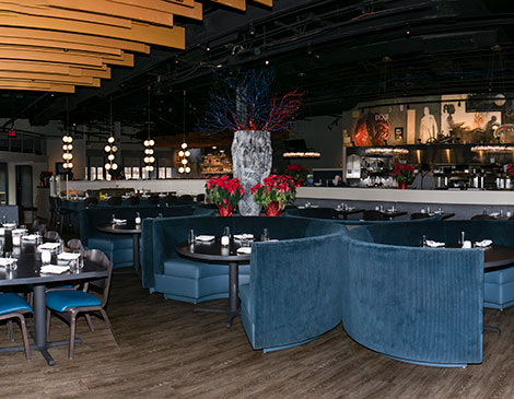 Blu, the Restaurant reinvents the former Moxie spot as a place for  surf-and-turf options, such as the  jumbo diver scallops.