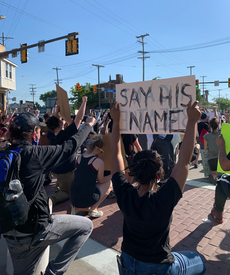 Demonstrators kneel at West 117th Street and Lorain Avenue.