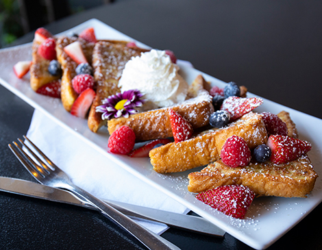 Executive chef Paul Mendolera often incorporates edible flowers into his dishes, such as the French toast served during the weekend brunch.