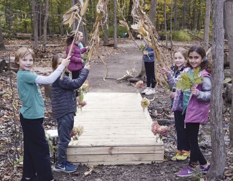 Fourth graders at Laurel School worked together to build and place a bridge on the school's Butler Campus.