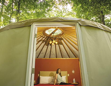 The Wilds, which offers 12 private yurts, covers 10,000 acres of land that animals such as giraffes and zebras can roam.