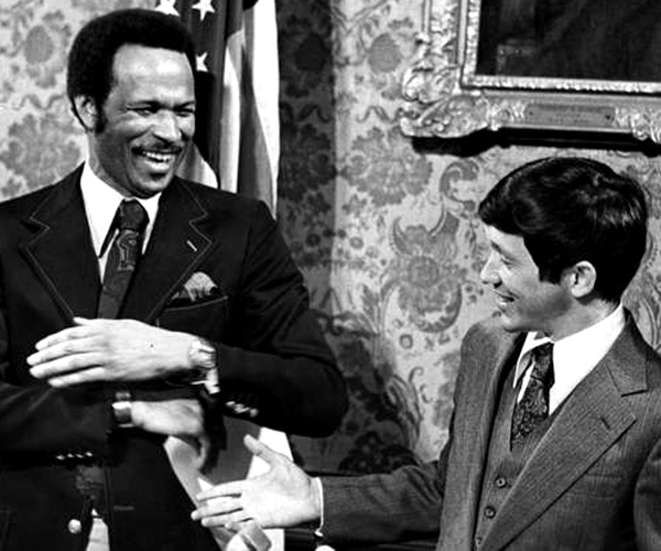 thumbnail_George_Forbes_and_Dennis_Kucinich_share_a_lighthearted_moment_at_City_Hall