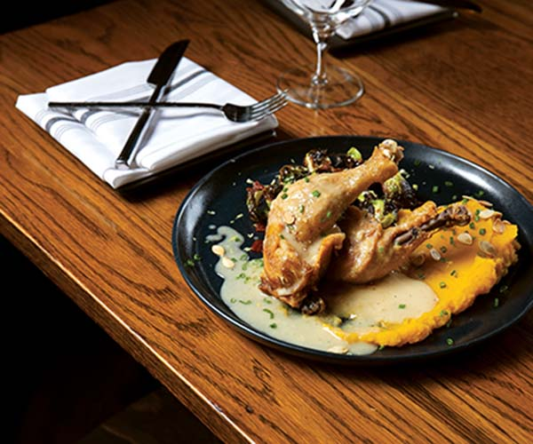 Thyme Table delivers decadent food such as the crispy chicken confit braised in coriander-laced duck fat.