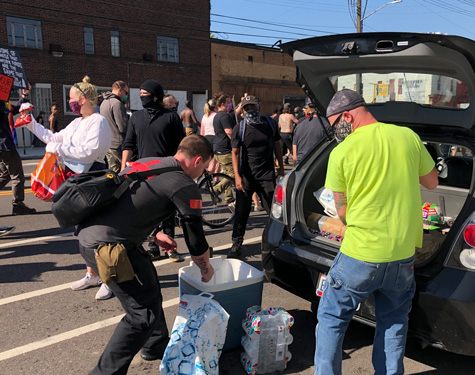 Volunteer medics hand out water and snacks at Tuesday's protest.